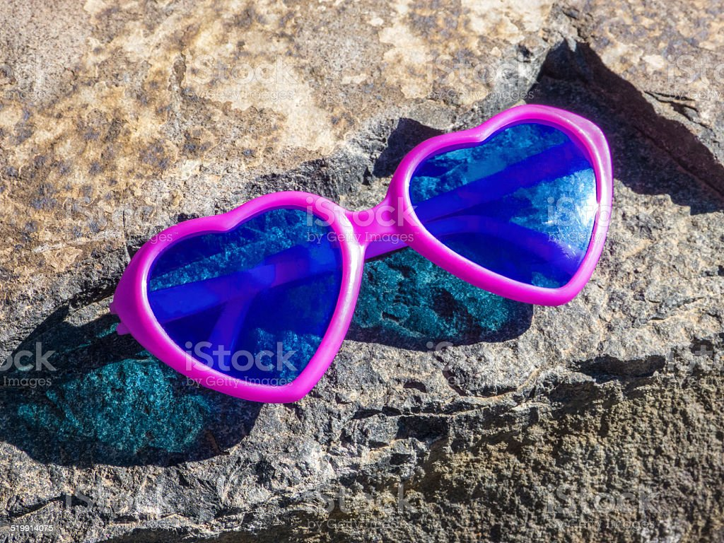 Heart-shaped pink sunglasses royalty-free stock photo