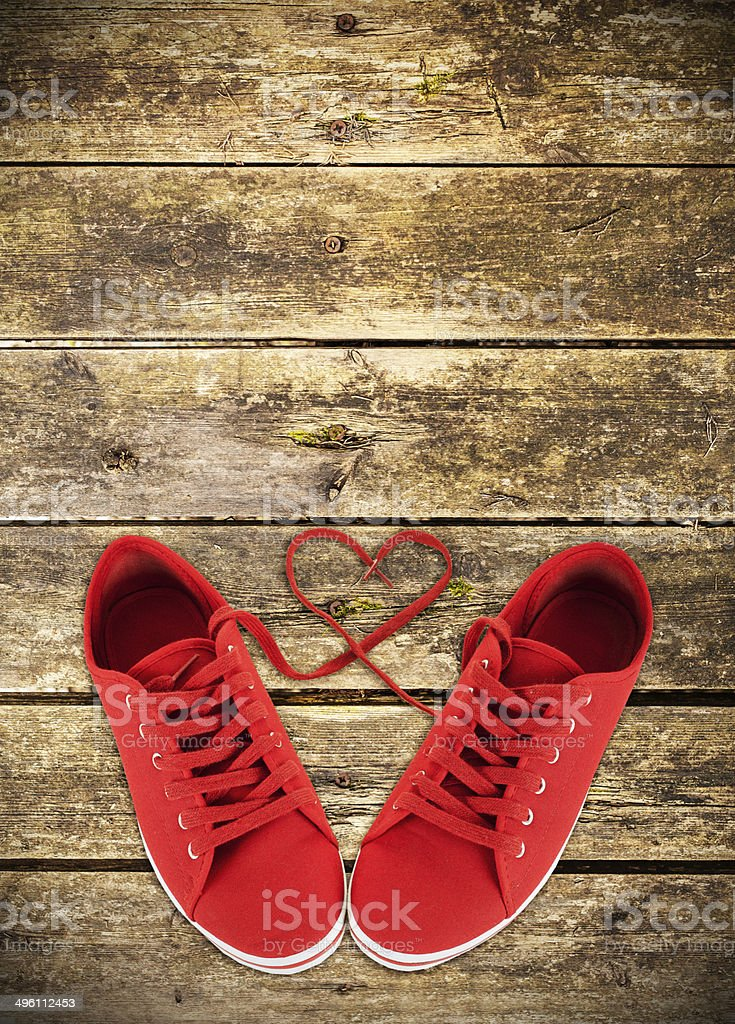 Heart-shaped red shoelaces stock photo