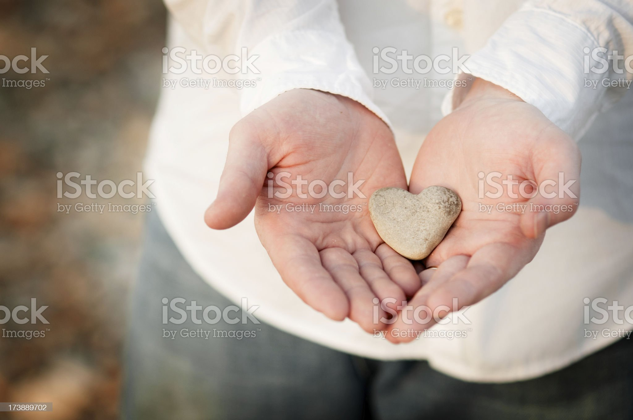 Heart-Shaped Rock in a Man's Hands royalty-free stock photo