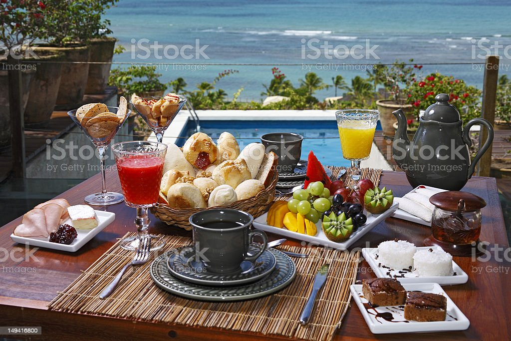 A hearty breakfast overlooking the beach royalty-free stock photo