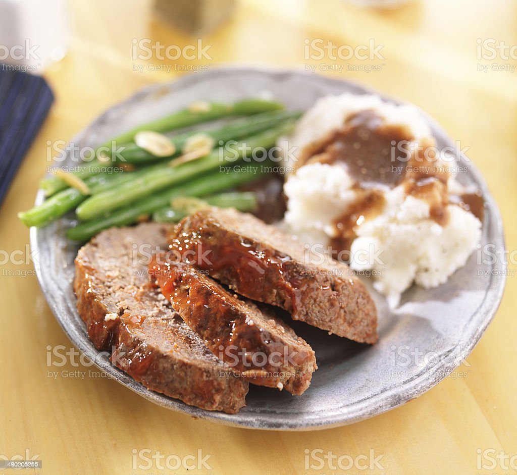 hearty meatloaf dinner with sides stock photo