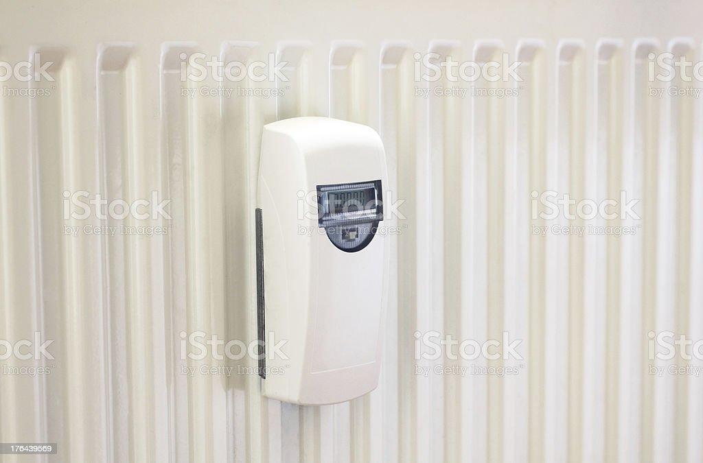 Heat cost allocator on radiator stock photo