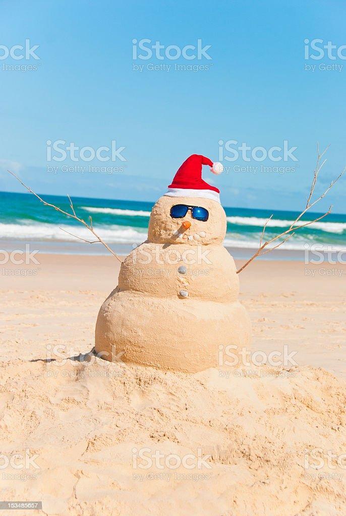 Heat Resistent Snowman Sunbathing On Beach stock photo