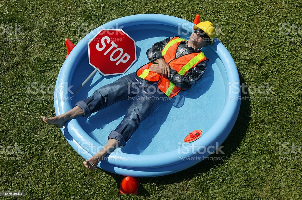 heat wave construction worker in swimming pool stock photo