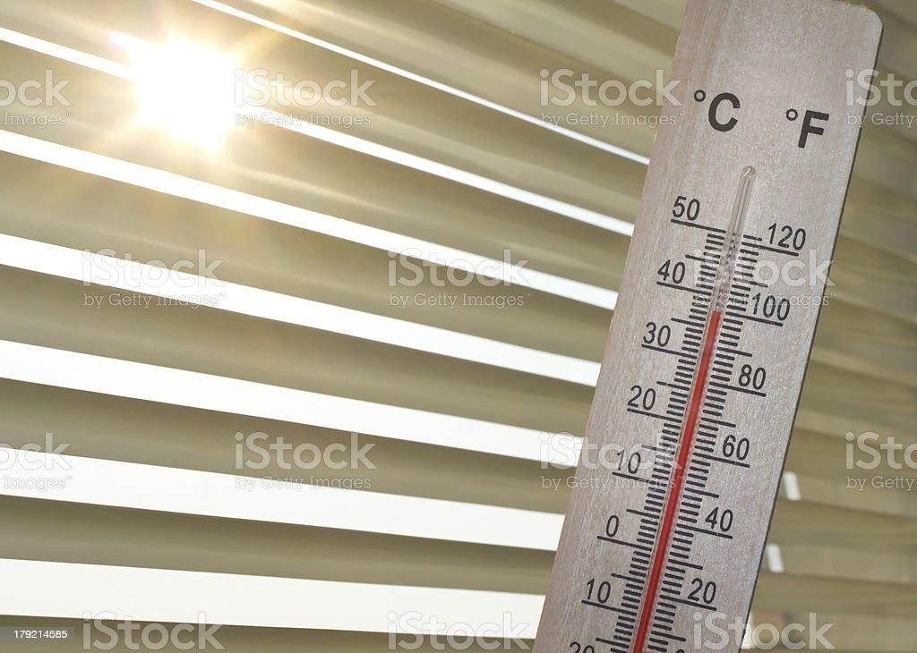 heat wave shown indoor on mercury thermometer stock photo