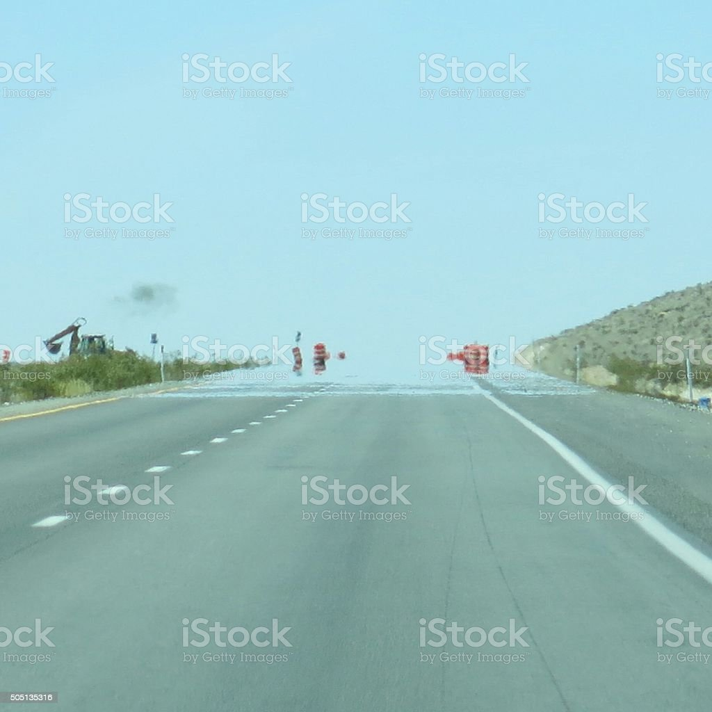 Heat Wave Water Mirage Illusion on Highway Road, Nevada Desert, stock photo