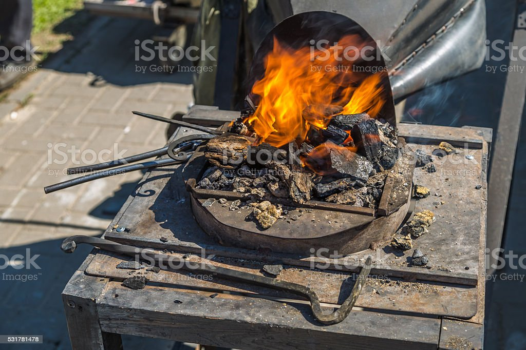 Heated horn with red coals stock photo