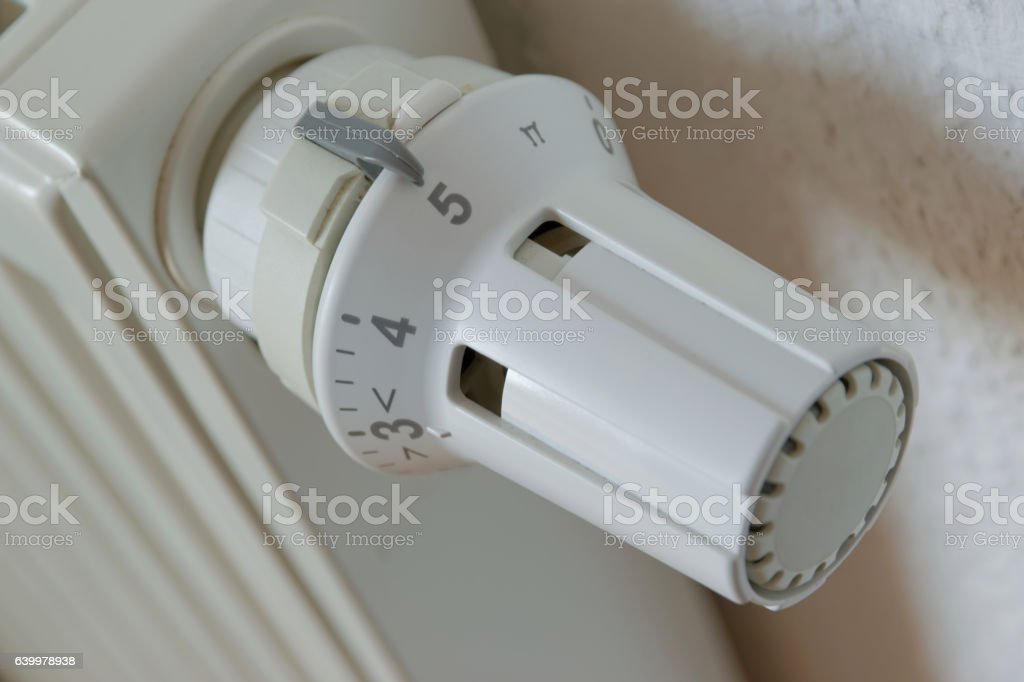 Heater thermostat at level 5 stock photo