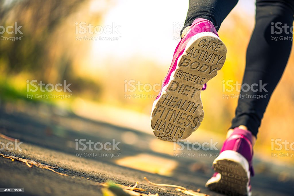 heath related word cloud on a runner's shoe soles stock photo