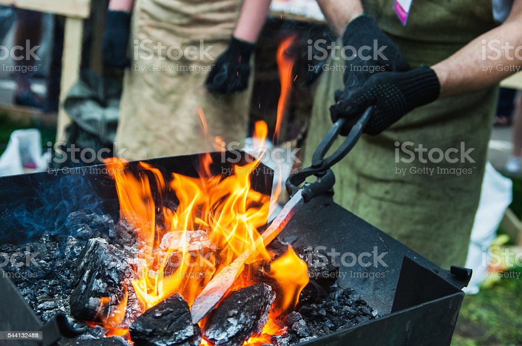 heating a metal workpiece stock photo