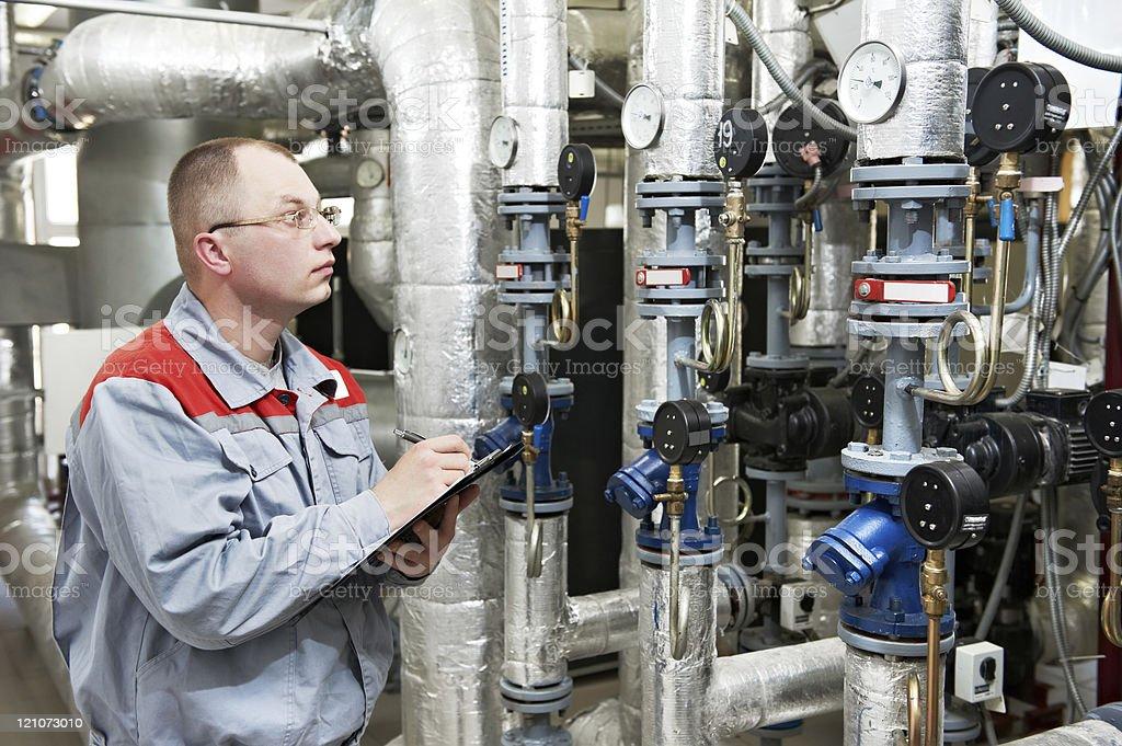 heating engineer in boiler room royalty-free stock photo