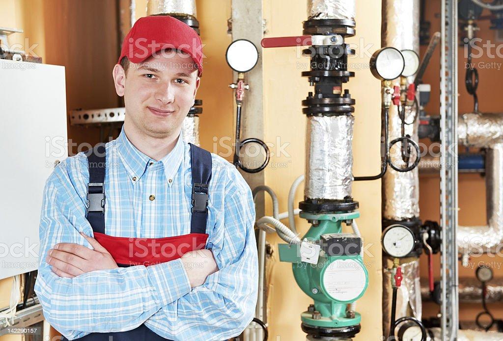 heating engineer repairman in boiler room royalty-free stock photo