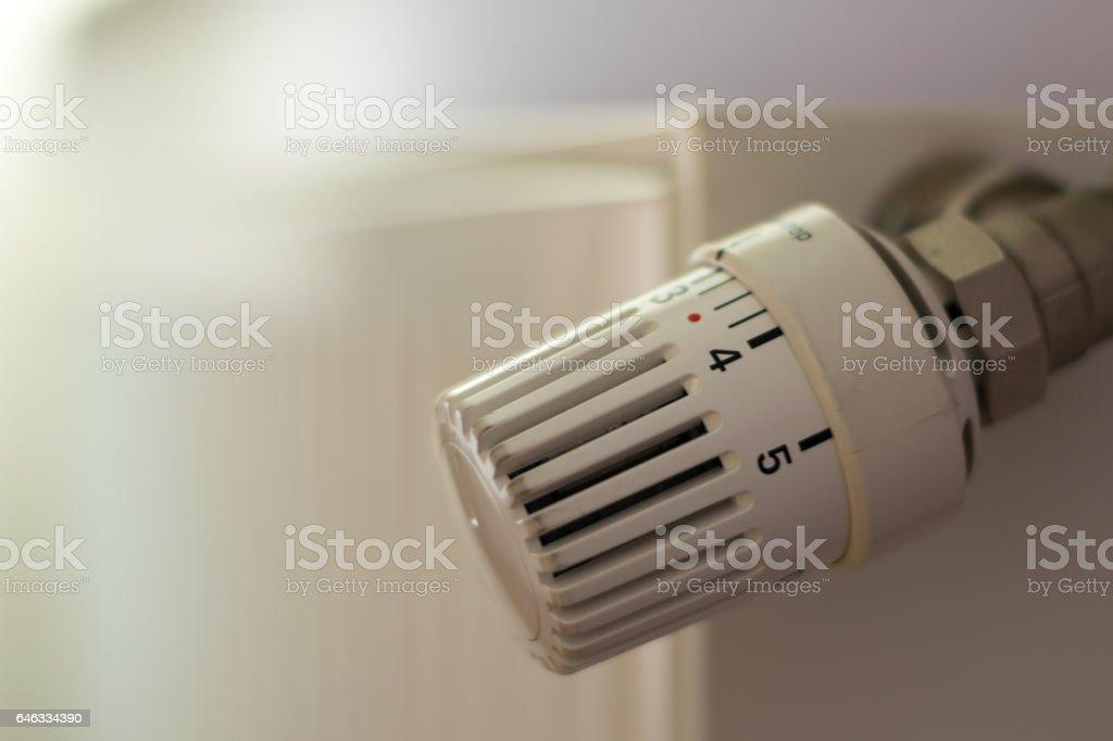 Heating Radiator Adjusting Knob Thermostat - selective focus stock photo