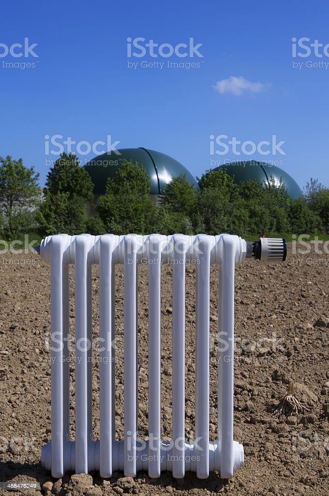 Heating radiator in front of biogas plant stock photo