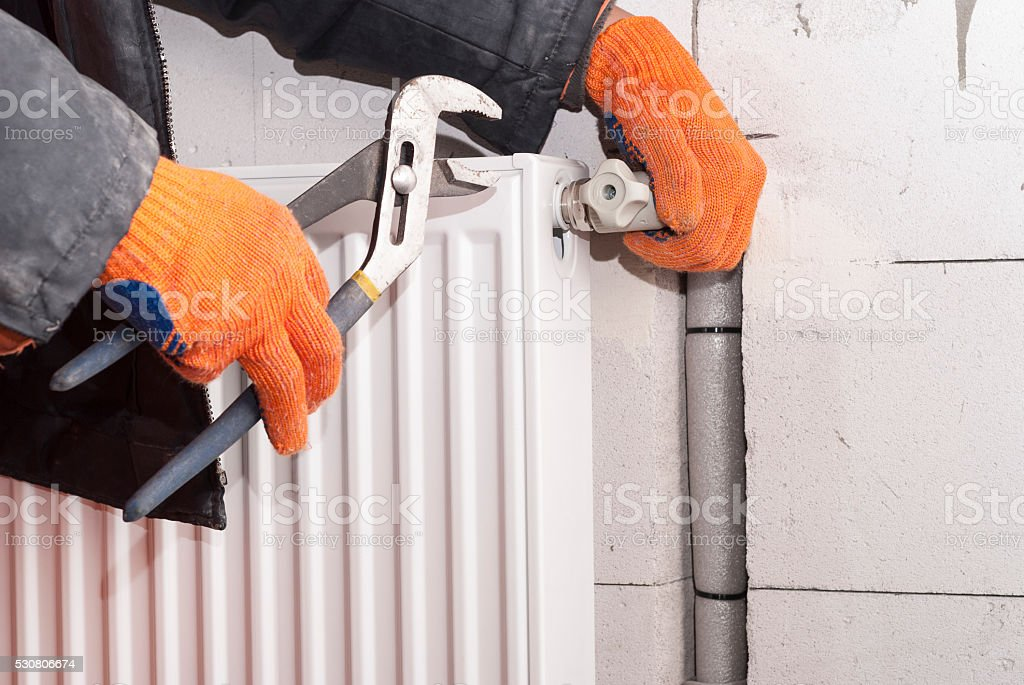heating radiator installation stock photo