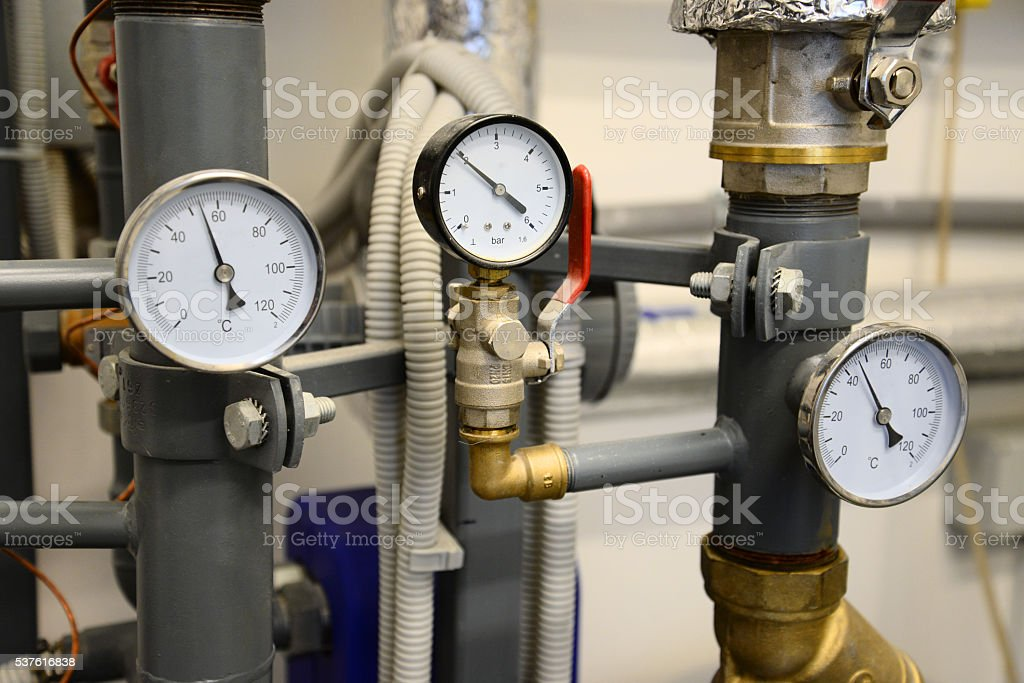 Heating system. Close up of pipes with manometers stock photo
