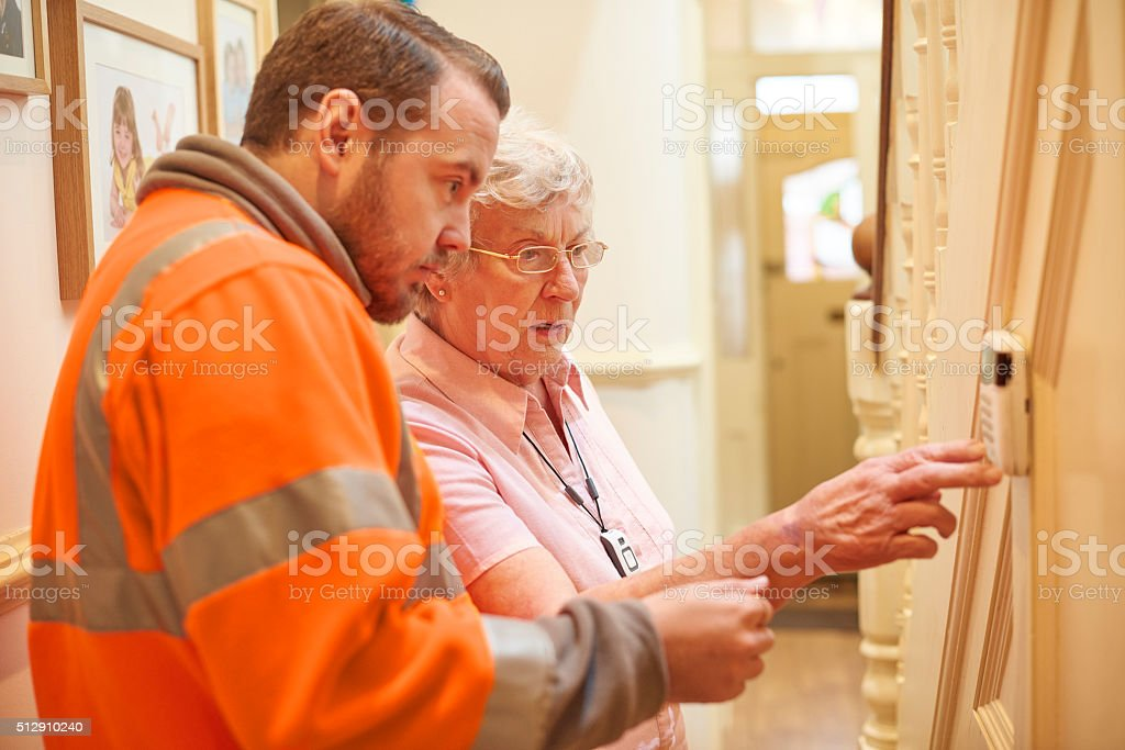 heating system for senior woman stock photo
