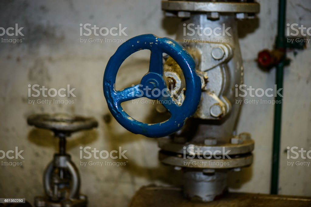 Heating system pipes and valves stock photo
