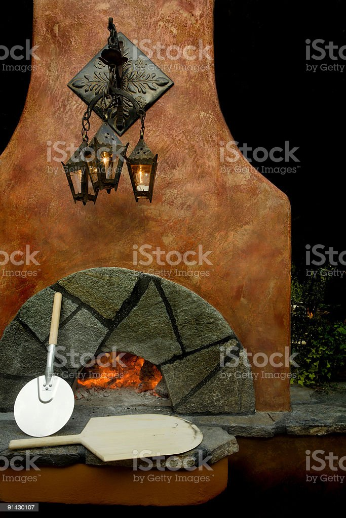 Heating the pizza oven stock photo
