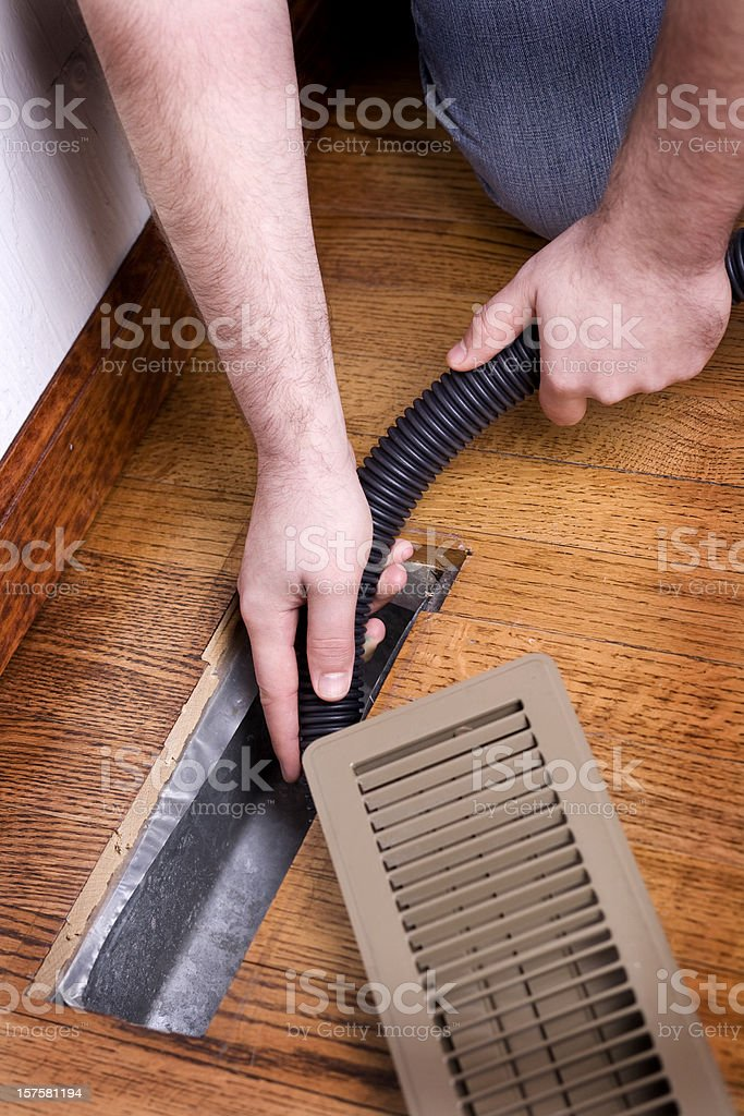 Heating Vent Air Duct Getting Cleaned stock photo