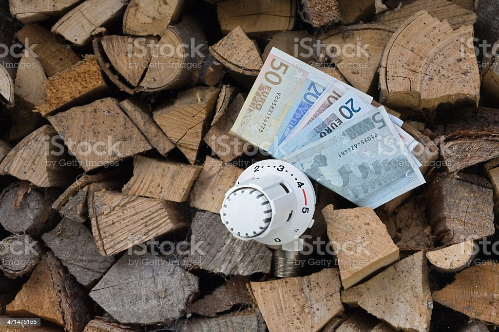 heating with wood stock photo