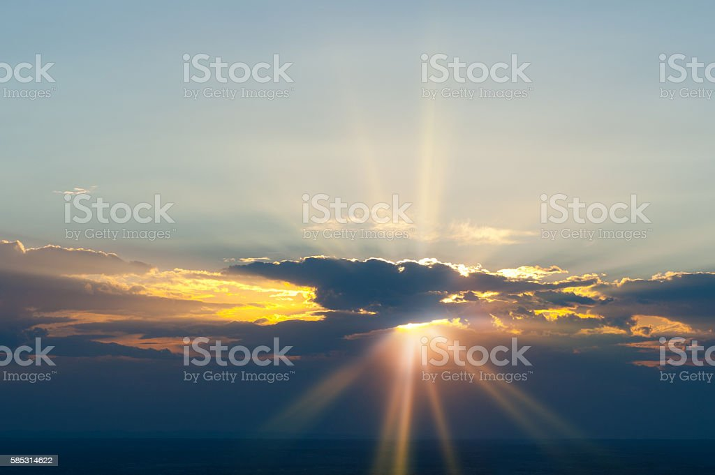Heavenly Cloud Sky with Sunrays at Sunset stock photo