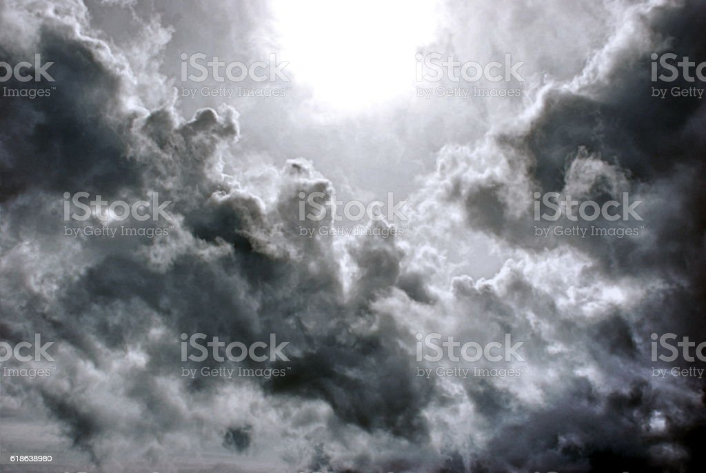 Heavenly Clouds; Light Shining through Black Cloudscape stock photo