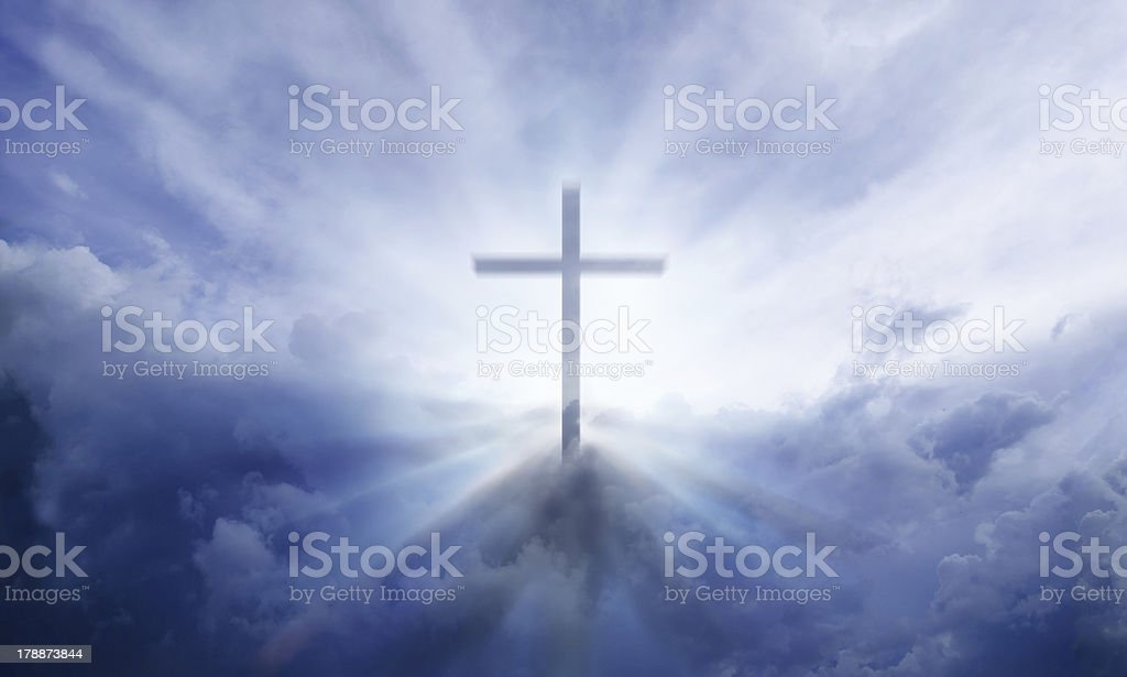 Heavenly cross in the sky with clouds and sun rays royalty-free stock photo