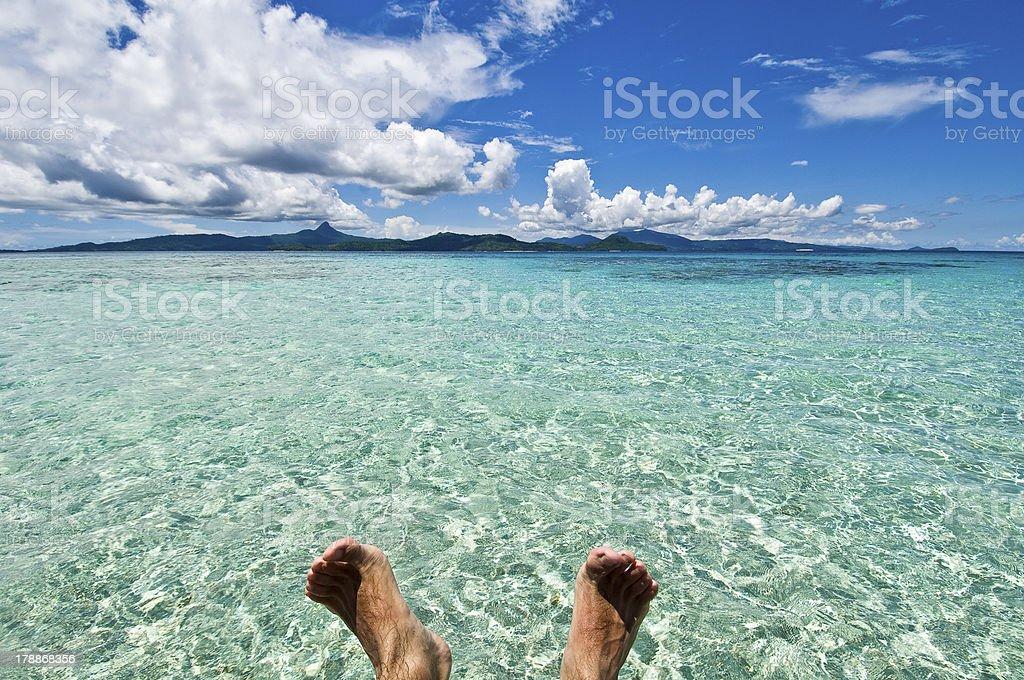 Heavenly scenery, lagoon, foot / Pieds nus, soleil, lagon, Mayotte stock photo