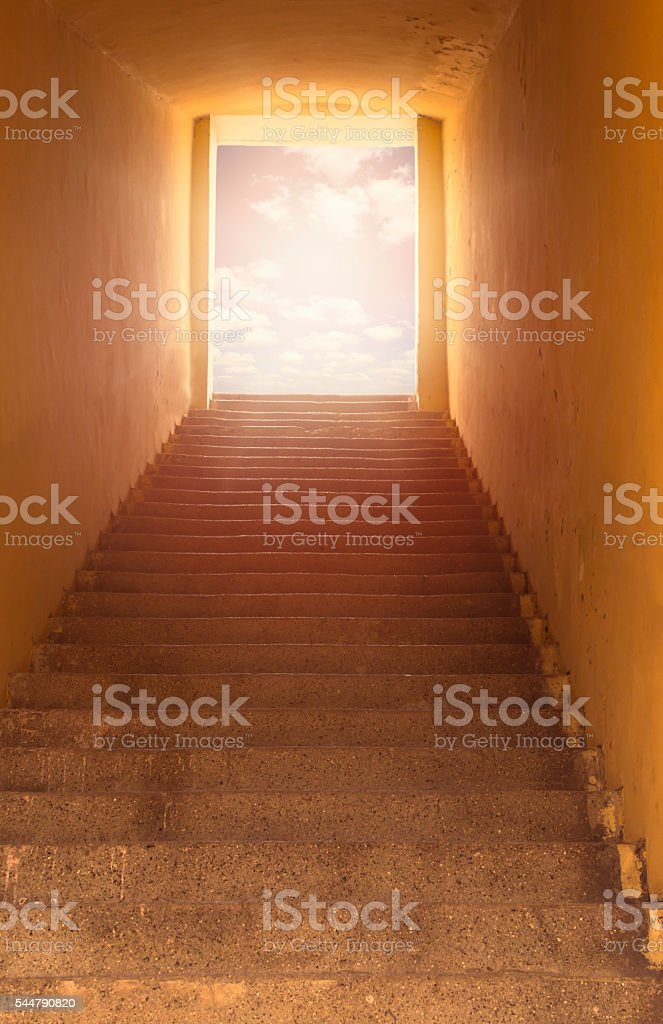 Heaven's gate. Staircase leading to open door and sky. stock photo
