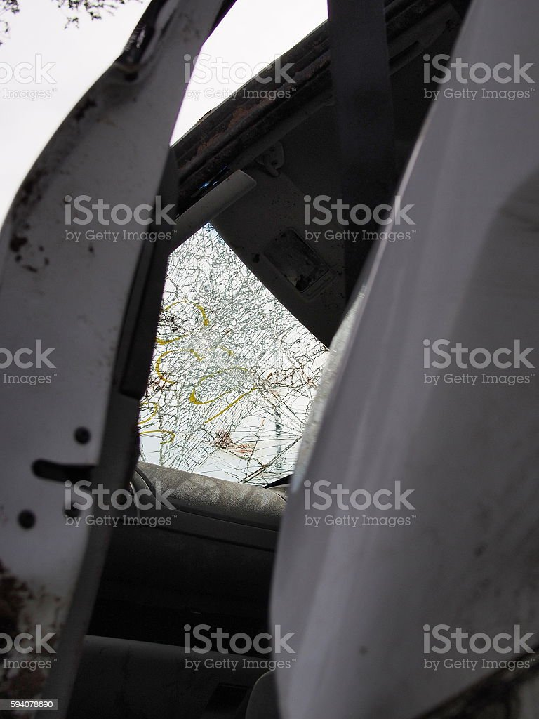 Heavily damaged car wind screen after a crash stock photo