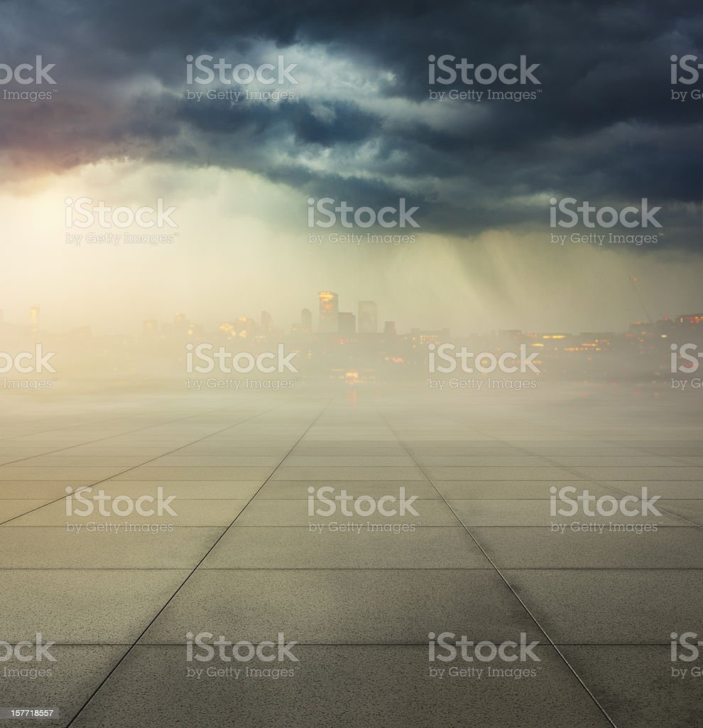 Heavily polluted city with smog in air and concrete ground stock photo