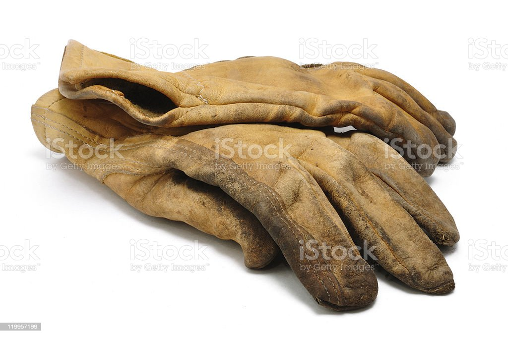 Heavily used leather work gloves stock photo
