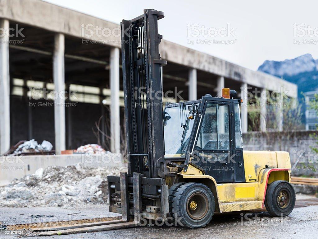heavy black orange diesel forklift truck at construction site stock photo