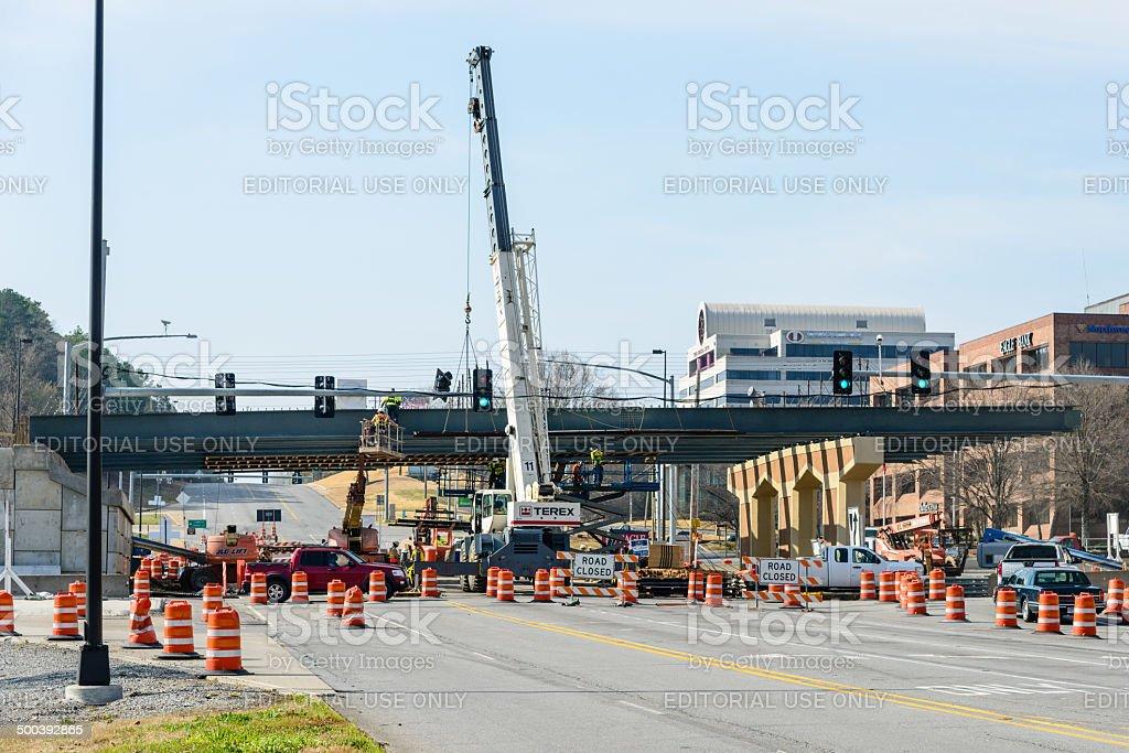 Heavy crane holding steel beams stock photo
