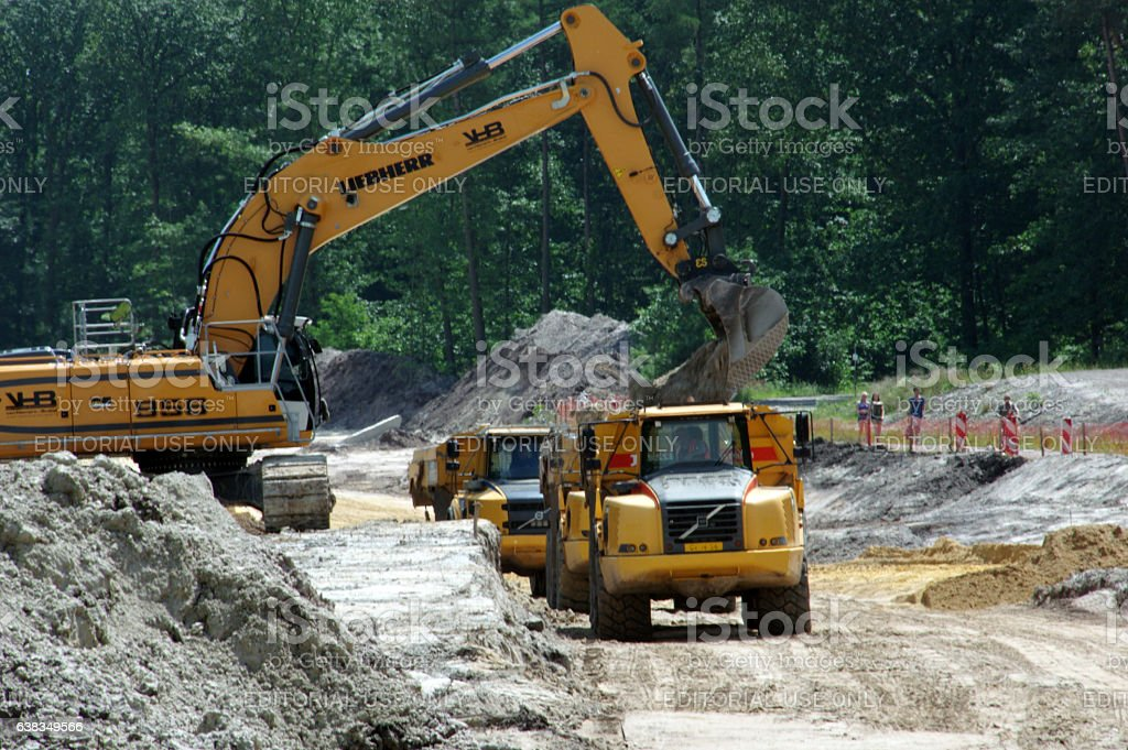 Heavy dumpers in action stock photo