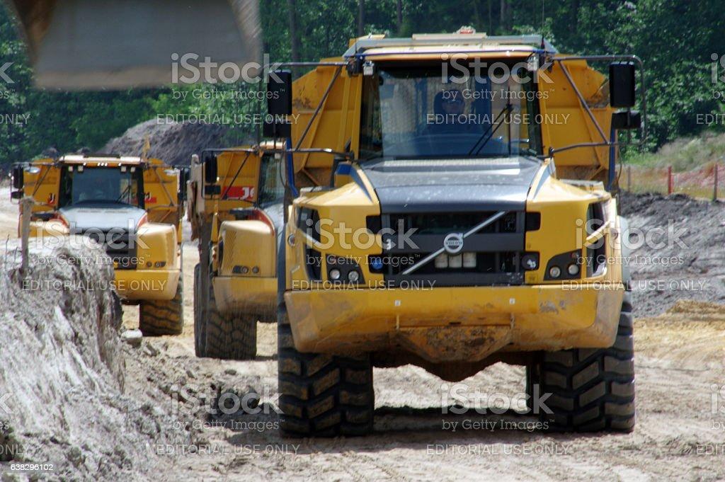 Heavy dumpers in line stock photo