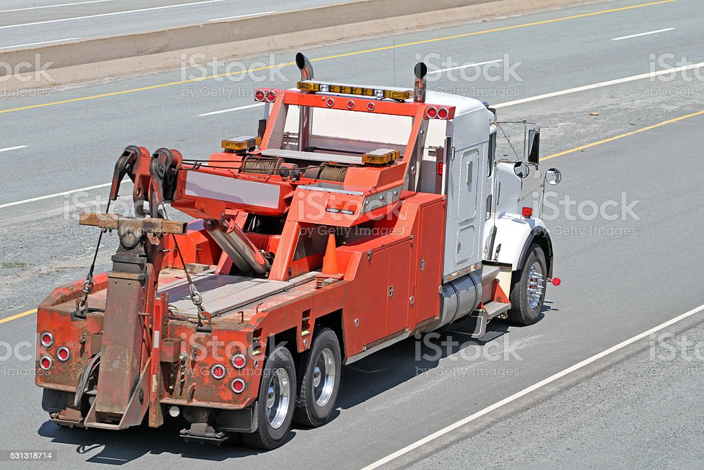 Heavy Duty Tow Truck Travelling On An Interstate Highway stock photo