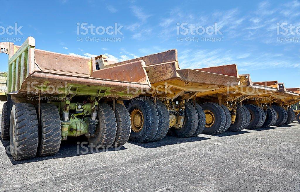 Heavy equipment industrial mining dump trucks stock photo