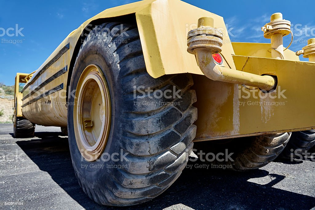 Heavy equipment water tanker industrial tires stock photo