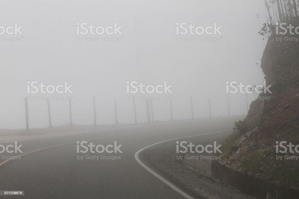 Heavy Fog on Curvy Road in Peru stock photo