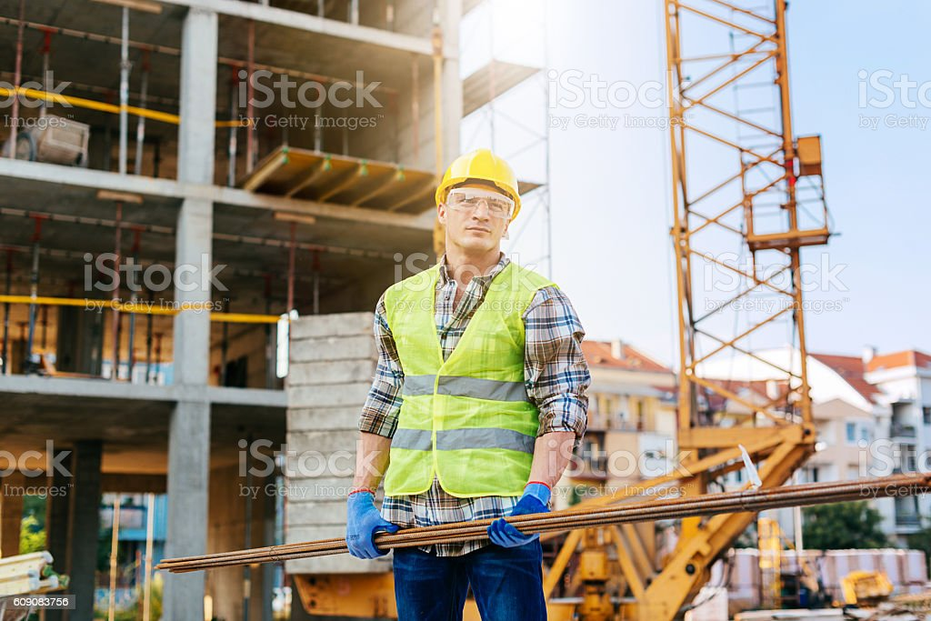Heavy load in the hands of construction worker stock photo