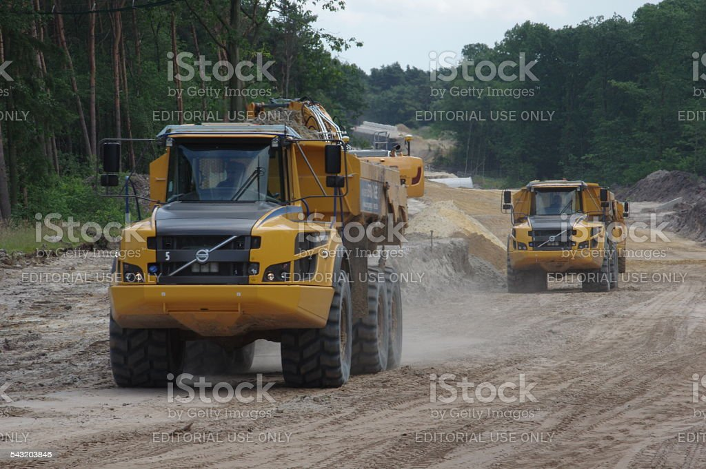Heavy loaders in action stock photo