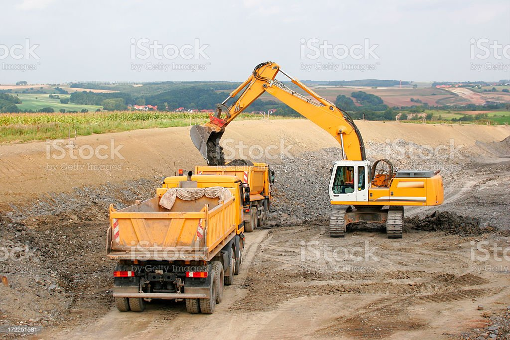 Heavy machinery at new highway site stock photo