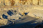 Heavy machinery in the granite quarry