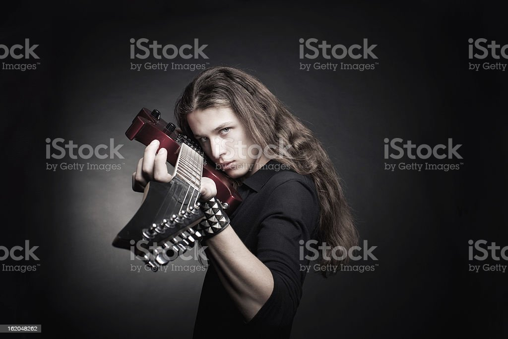 Heavy metal guitarist royalty-free stock photo