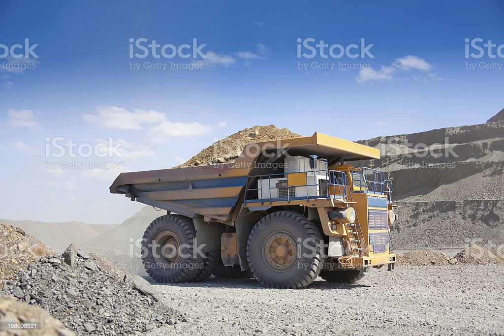 Heavy mining dump truck driving along the opencast stock photo