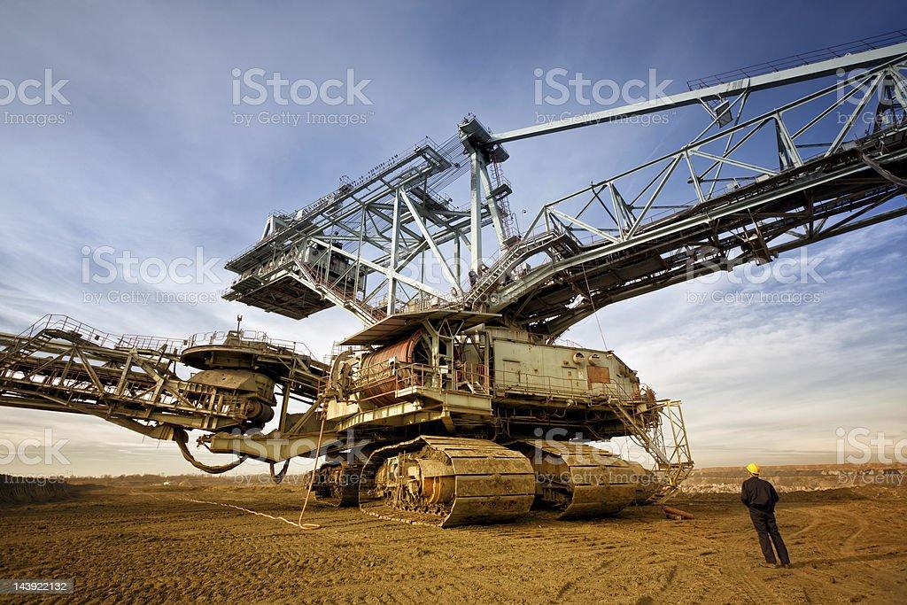 Heavy mining industry worker stock photo
