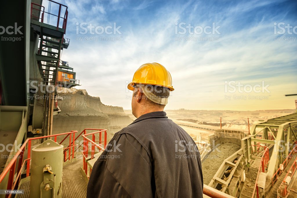 Heavy mining industry worker stock photo
