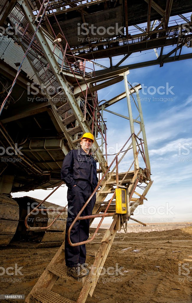 A heavy mining industry worker posing for a picture royalty-free stock photo